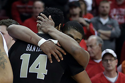 20 March 2017:  B.J. Taylor hugs Nick Banyard during a College NIT (National Invitational Tournament) 2nd round mens basketball game between the UCF (University of Central Florida) Knights and Illinois State Redbirds in  Redbird Arena, Normal IL