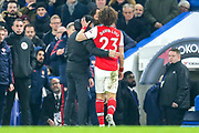 RED CARD Arsenal manager Mikel Arteta puts his arm around  Arsenal defender David Luiz (23) following his sending off  during the Premier League match between Chelsea and Arsenal at Stamford Bridge, London, England on 21 January 2020.