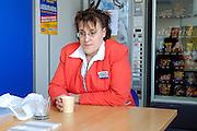 Hôtesse de Caisse au Centre Leclerc de Margon (28) , 2004.