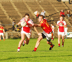 Ballintubber's Alan Dillon in action against Castlebar Mitchels Danny Kirby.during the Mayo Senior Football Final..Pic Conor McKeown