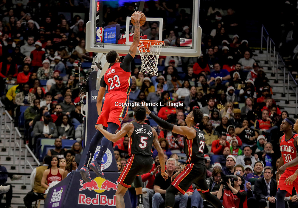 Dec 16, 2018; New Orleans, LA, USA; New Orleans Pelicans forward Anthony Davis (23) dunks over Miami Heat forward Derrick Jones Jr. (5) and center Hassan Whiteside (21) during the first half at the Smoothie King Center. Mandatory Credit: Derick E. Hingle-USA TODAY Sports