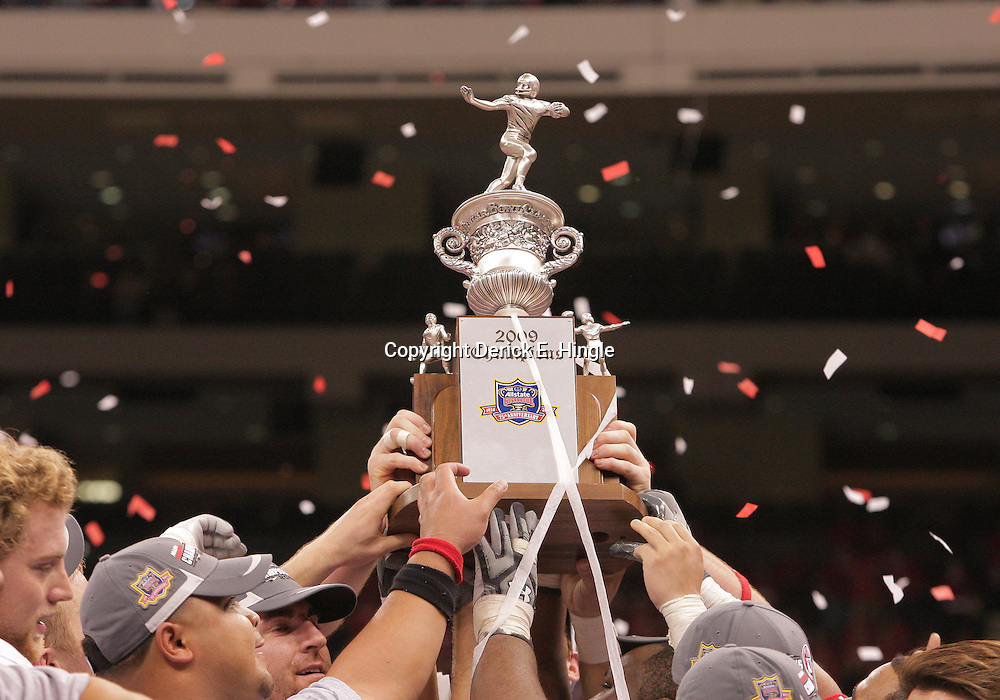 2 January 2009: Utah players hold up the Allstate Sugar Bowl championship trophy following a 31-17 win by the Utah Utes over the Alabama Crimson Tide in the 75th annual Allstate Sugar Bowl at the Louisiana Superdome in New Orleans, LA.