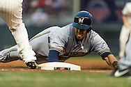 Carlos Gomez #27 of the Milwaukee Brewers dives safely back into 1st base on a pickoff attempt during a game against the Minnesota Twins on May 29, 2013 at Target Field in Minneapolis, Minnesota.  The Twins defeated the Brewers 4 to 1.  Photo: Ben Krause