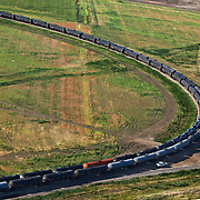 Train cars carrying crude oil from the Bakken formation are filled outside of Trenton, North Dakota.The oil boom is redrawing North Dakota's landscape and creating opportunity for thousands of unemployed Americans. However, the economic prosperity has exacerbated problems in housing, infrastructure and traffic...Known for the beauty of its great plains, North Dakota has long been the least populated state in the country. Because of the Bakken oil boom, everyday, mostly men, pour in from across the nation looking for work. The small town of Williston has exploded as a result. Ten years ago Williston, North Dakota was a quiet agricultural town with a population around 12,000. In a decade the population has more than doubled to over 30,000. More than half of Williston's residents now work in oil-related jobs and the city's unemployment rate is at 1 percent, which is the lowest in the U.S...