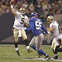 2009 October 18: New Orleans Saints quarterback Drew Brees (9) throws a pass against the New York Giants during a 48-27 win by the New Orleans Saints over the New York Giants at the Louisiana Superdome in New Orleans, Louisiana.