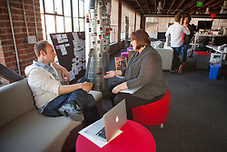 Scenes from Pinterest Headquarters in San Francisco, California.  Employees work in fun environment.