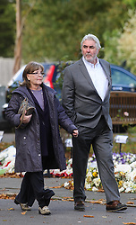© Licensed to London News Pictures. 07/10/2014London, UK. Pauline Collins and John Alderton arriving for the funeral of singer Lynsey de Paul in Hendon, North London Photo credit : Simon Jacobs/LNP