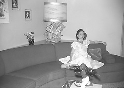 woman alone on a couch