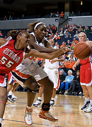 Virginia center Aisha Mohammed (33) and Richmond forward/center Crystal Goring (55) fight for a loose ball on the baseline.  The Virginia Cavaliers women's basketball team faced the Richmond Spiders at the John Paul Jones Arena in Charlottesville, VA on November 18, 2007.