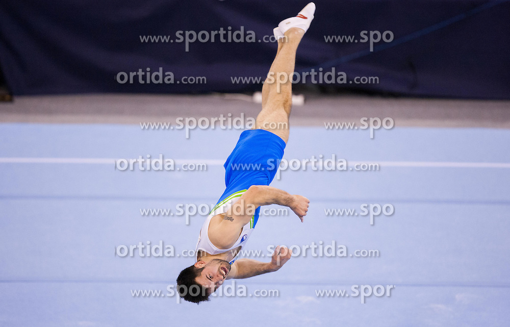 Rok Klavora of Slovenia competes in the Floor Exercise during Final day 1 of Artistic Gymnastics World Challenge Cup Ljubljana, on April 19, 2014 in Hala Tivoli, Ljubljana, Slovenia. Photo by Vid Ponikvar / Sportida