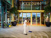 09 NOVEMBER 2018 - BANGKOK, THAILAND: A worker cleans the floor in front of the entrance to ICONSIAM before the grand opening. ICONSIAM opened November 9. ICONSIAM is a mixed-use development on the Thonburi side of the Chao Phraya River. It includes two large malls, with more than 520,000 square meters of retail space, an amusement park, two residential towers and a riverside park. It is the first large scale high end development on the Thonburi side of the river and will feature the first Apple Store in Thailand and the first Takashimaya department store in Thailand.    PHOTO BY JACK KURTZ