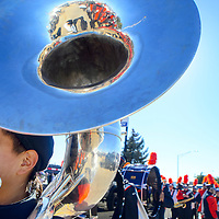1003613  Adron Gardner/Independent<br /> <br /> Terrell Daw rests his tuba before the start of the Gallup High School homecoming parade on Coal Avenue in Gallup Friday.