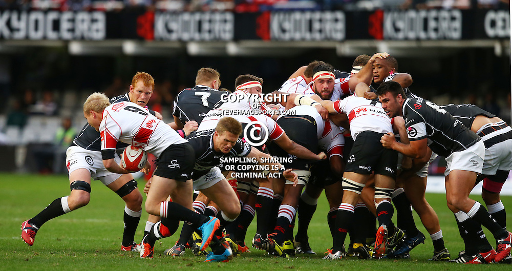 DURBAN, SOUTH AFRICA - AUGUST 22:  Michael Claassens of the Cell C Sharks tackling Ross Cronje of the Xerox Golden Lions during the Absa Currie Cup match between Cell C Sharks and Xerox Golden Lions at Growthpoint Kings Park on August 22, 2015 in Durban, South Africa. (Photo by Steve Haag/Gallo Images)