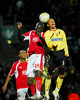 Photo: Leigh Quinnell/Sportsbeat Images.<br /> Watford v Bristol City. Coca Cola Championship. 01/12/2007. Bristol Citys Enoch Showunmi rises high with Watfords  Jordan Stewart.