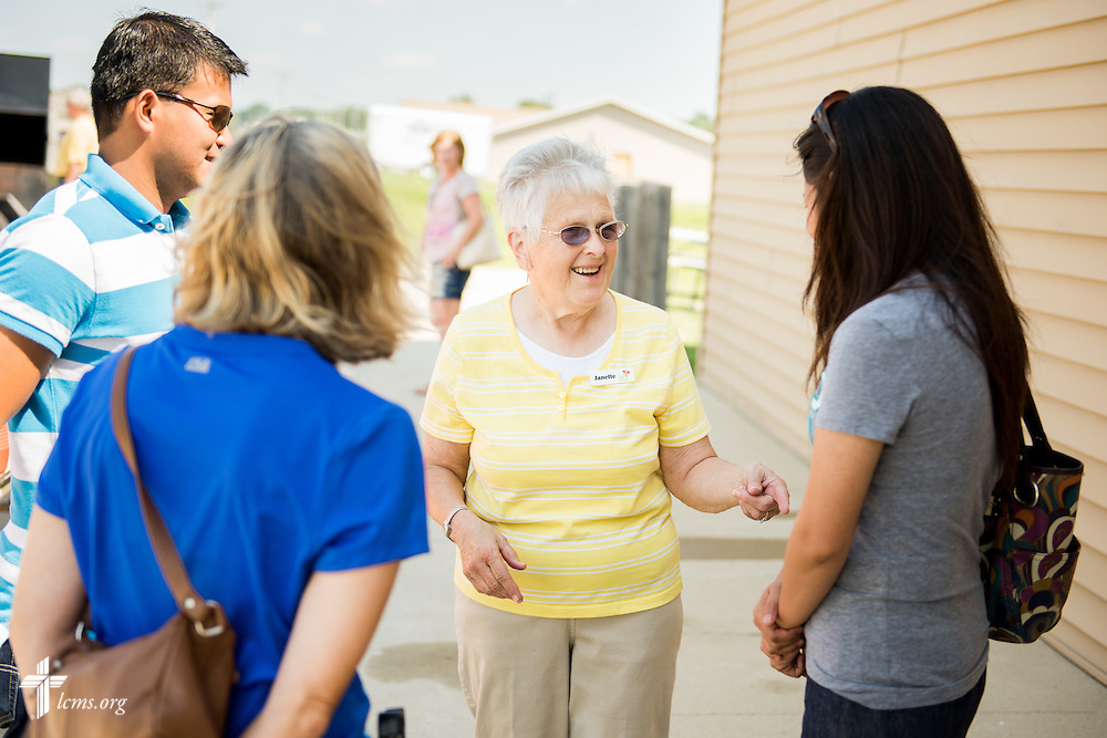Janette Lang, parishioner of Trinity Lutheran Church in Creston, Iowa, greets (L-R) Arnie Suan, Barb Erickson, and Sweet Rose Suan, during the grand opening of the Iowa Life Care (LC) Clinic on Saturday, Aug. 15, 2015, in Creston, Iowa. The clinic is a former Planned Parenthood facility. LCMS Communications/Erik M. Lunsford