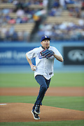 LOS ANGELES, CA - AUGUST 22:  Actor  Jesse Tyler Ferguson, co-star of the comedy television series Modern Family, runs home to deposit the ball with the catcher as he throws out the celebratory first pitch before the Los Angeles Dodgers game against the New York Mets at Dodger Stadium on Friday, August 22, 2014 in Los Angeles, California. The Dodgers won the game 6-2. (Photo by Paul Spinelli/MLB Photos via Getty Images) *** Local Caption *** Jesse Tyler Ferguson