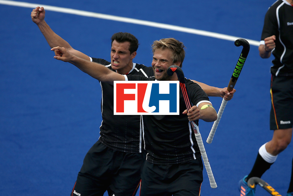 RIO DE JANEIRO, BRAZIL - AUGUST 11:  Timur Oruz #27 and Moritz Furste #21 of Germany react to scoring a goal against Argentina during a Men's Preliminary Pool B match on Day 6 of the Rio 2016 Olympics at the Olympic Hockey Centre on August 11, 2016 in Rio de Janeiro, Brazil.  (Photo by Sean M. Haffey/Getty Images)