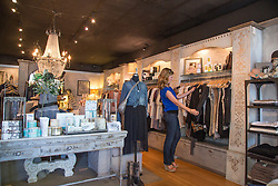 United States, Washington, Kirkland, young woman shopping in a boutique
