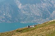 Italy, Monte Baldo Hiker family at rest overlooking Lake Garda,