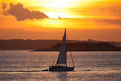 © Licensed to London News Pictures. 02/10/2016. Southsea, Hampshire, UK. A yacht sails into Portsmouth Harbour during the last of the evening light on what has been another warm and sunny autumn day in the South of England. Photo credit: Rob Arnold/LNP