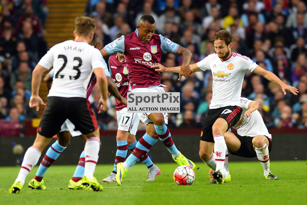 Jordan Ayew of Aston Villa is challenge by Luke Shaw and Danny Blind of Man.Utd