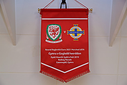 NEWPORT, WALES - Tuesday, September 3, 2019: The official match pennant hanging in the dressing room before the UEFA Women Euro 2021 Qualifying Group C match between Wales and Northern Ireland at Rodney Parade. (Pic by David Rawcliffe/Propaganda)