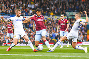 Tyrone Mings of Aston Villa (40) Liam Cooper of Leeds United (6) and Kalvin Phillips of Leeds United (23) in action during the EFL Sky Bet Championship match between Leeds United and Aston Villa at Elland Road, Leeds, England on 28 April 2019.