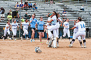 05/20/2013 - Eau Claire, Wis. - The Tufts University softball team celebrates after winning the NCAA Division III College World Series championship game against SUNY Cortland on Monday, May 20, 2013. The Jumbos defeated the Red Dragons 6-5. (Alonso Nichols/Tufts University)