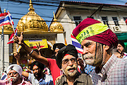 05 JANUARY 2014 - BANGKOK, THAILAND: Thai-Indian Sikhs who support the anti-government movement cheer during an anti-government march in Bangkok. Suthep Thaugsuband, leader of the anti-government protests in Bangkok, led the protestors on a march through the Chinatown district of Bangkok. Tens of thousands of people waving Thai flags and blowing whistles gridlocked what was already one of the most congested parts of the city. The march was intended to be a warm up to their plan by protestors to completely shut down Bangkok starting Jan. 13.     PHOTO BY JACK KURTZ