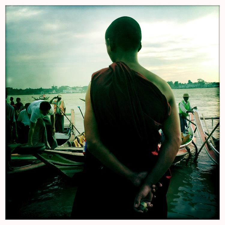 People prepare to board small local ferries to make the river crossing to Dallah. Yangon (Rangoon) Myanmar (Burma) January 2012