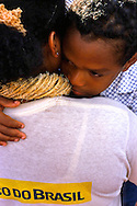 A child hugs his mum at the end of the  Círio parade