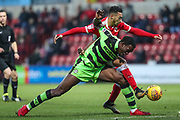 Forest Green Rovers Isaiah Osbourne(34) tangles with Swindon Town's Keshi Anderson(30) during the EFL Sky Bet League 2 match between Swindon Town and Forest Green Rovers at the County Ground, Swindon, England on 13 January 2018. Photo by Shane Healey.