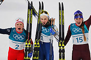 PYEONGCHANG-GUN, SOUTH KOREA - FEBRUARY 13: Maiken Caspersen Falla of Norway, Stina Nilsson of Sweden and Yulia Belorukova of Olympic Athletes of Russia celebrates after the Womens Individual Sprint Classic Finals on day four of the PyeongChang 2018 Winter Olympic Games at Alpensia Cross-Country Skiing Centre on February 13, 2018 in Pyeongchang-gun, South Korea. Photo by Nils Petter Nilsson/Ombrello               ***BETALBILD***