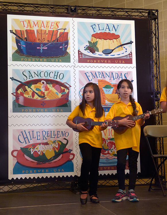 gbs042017b/ASEC -- Coronado Elementary students, Emily Chavez, 8, left, and Antonella Aragon, 8, sing with the Voces de Coronado at the new U.S. Postal Service Delicioso Forever stamps unveiling at the National Hispanic Cultural Center on Thursday, April 20, 2017. (Greg Sorber/Albuquerque Journal)