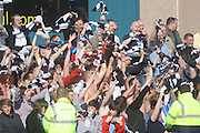 Dundee fans celebrate their side's 'Great Escape' - The Dark Blues secured their First Division place for next season, despite a 25 point penalty for going into administration, by winning at Ross County - Ross County v Dundee - IRN BRU Scottish Football League First Division at Victoria Park<br /> <br /> <br /> <br /> http://www.davidyoungphoto.co.uk