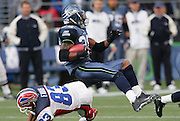 SEATTLE - NOVEMBER 28:  Free safety Ken Hamlin #26 of the Seattle Seahawks gets tackled by wide receiver Lee Evans #83 of the Buffalo Bills after pulling down one of his two interceptions for the day at Qwest Field on November 28, 2004 in Seattle, Washington. The Bills defeated the Seahawks 38-9. ©Paul Anthony Spinelli *** Local Caption *** Ken Hamlin;Lee Evans