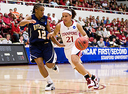 March 20, 2010; Stanford, CA, USA; Stanford Cardinal guard Rosalyn Gold-Onwude (21) dribbles past UC Riverside Highlanders guard Alyssa Morris (12) during the first half in the first round of the 2010 NCAA womens basketball tournament at Maples Pavilion.  Stanford defeated UC Riverside 79-47.