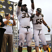 ORLANDO, FL - JANUARY 01:  Most Valuable Player of the game Markus Golden #33 of the Missouri Tigers celebrates on the podium after winning the Buffalo Wild Wings Citrus Bowl between the Minnesota Golden Gophers and the Missouri Tigers at the Florida Citrus Bowl on January 1, 2015 in Orlando, Florida. (Photo by Alex Menendez/Getty Images) *** Local Caption *** Markus Golden