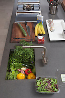 Fresh food preparation on kitchen counter with sink