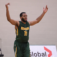 4th year forward Brian Ofori (11) of the Regina Cougars celebrates during the home game on November  5 at Centre for Kinesiology, Health and Sport. Credit: /Arthur Images