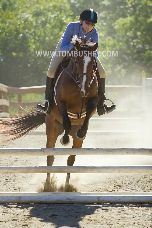 Middletown, New York - A horse and rider jump a barrier during the 70th annual Middletown Rotary Horse Show, which was held in the Rotary Ring at Fancher-Davidge Park on Sept. 8, 2013.