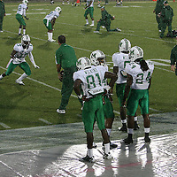 Marshall players warm up in the rain prior to an NCAA football game between the Marshall Thundering Herd and the Central Florida Knights at Bright House Networks Stadium on Saturday, October 8, 2011 in Orlando, Florida. Thunderstorms are expected for this evenings game.(Photo/Alex Menendez)