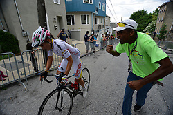 Long time volunteer MELVIN MOORE cheers on top of his longs as riders climb the Manayunk Wall during the UCI Women's World Tour Philadelphia Cycling Classic on Sunday June 5th, 2016. Pro-cyclist compete at a 73.8miles/118.7km course in Philadelphia Pennsylvania