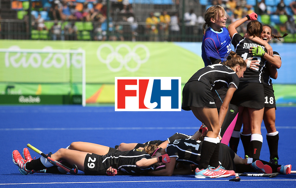 TOPSHOT - Germany's players celebrate after winning the women's Bronze medal hockey Germany vs New Zealand match of the Rio 2016 Olympics Games at the Olympic Hockey Centre in Rio de Janeiro on August 19, 2016. / AFP / MANAN VATSYAYANA        (Photo credit should read MANAN VATSYAYANA/AFP/Getty Images)