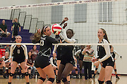 The ball gets past Cedar Ridge's Jessica Finch Tuesday at Cedar Ridge Gym.  The Lady Dragons beat the Lady Raiders in four games.  (LOURDES M SHOAF for Round Rock Leader.)