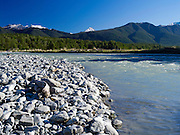 Low-angle view of the Maruia River and cobbles, with the Victoria Range in the background; Canterbury, New Zealand; June 2013