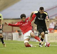 Photo: Aidan Ellis.<br /> Barnsley v Cardiff City. Coca Cola Championship. 29/09/2007.<br /> Barnsley's Miguel Mostto (L) challenges Cardiff's Joe Ledley