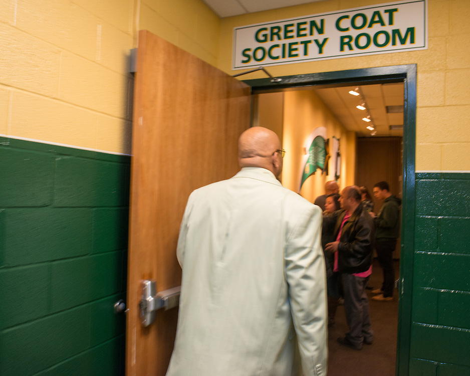 December 5, 2015 - Fairfax, VA - A day in the life of &quot;Doc Nix,&quot; aka Dr. Michael Nickens, the Director of the Athletic Bands for George Mason University. Here Doc Nix enters the Green Coat Society Room filled with Mason supporters and donors.<br /> <br /> <br /> Photo by Susana Raab