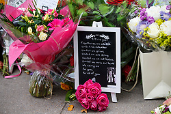 © Licensed to London News Pictures. 07/07/2015. London, UK. Flowers left for 7/7 London bombings victims on the 10th anniversary of 7/7 London bombings in Tavistock Square on Tuesday, July 7, 2015. Photo credit: Tolga Akmen/LNP