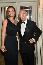 SIR ROBERT & LADY OGDEN at the 24th Cartier Racing Awards held at The Dorchester, Park Lane, London on 11th November 2014.